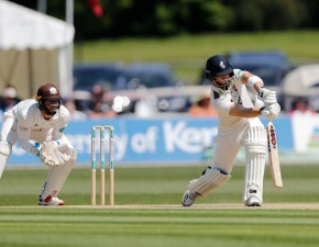 Determined display secures Surrey draw