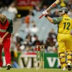 Australian batsman Michael Bevan (R) cel