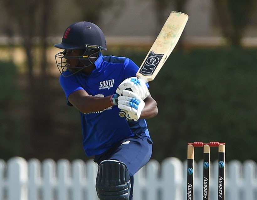 Daniel Bell-Drummond carries bat as South thrash North